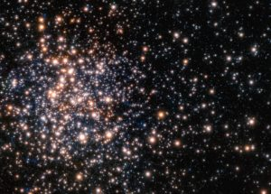 Scientists are Astonished By Massive Star Cluster Hiding Just Behind the Cosmic Scenes